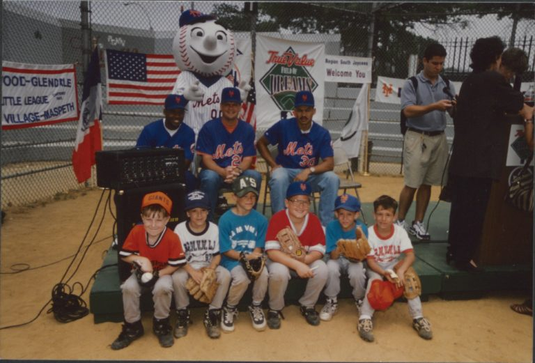 Alberto Castillo, Alex Ochoa and Bruce Benedict Pose With Mr. Met and a Group of 6 Young Fans