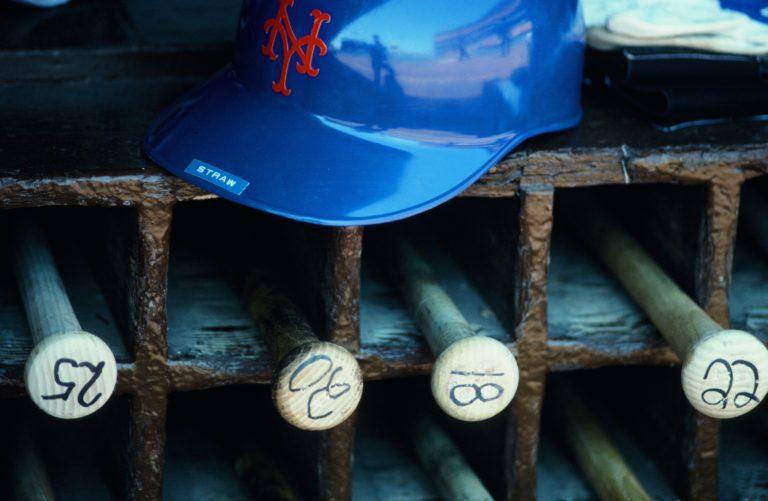 Mets Bats and Helmet in Dugout