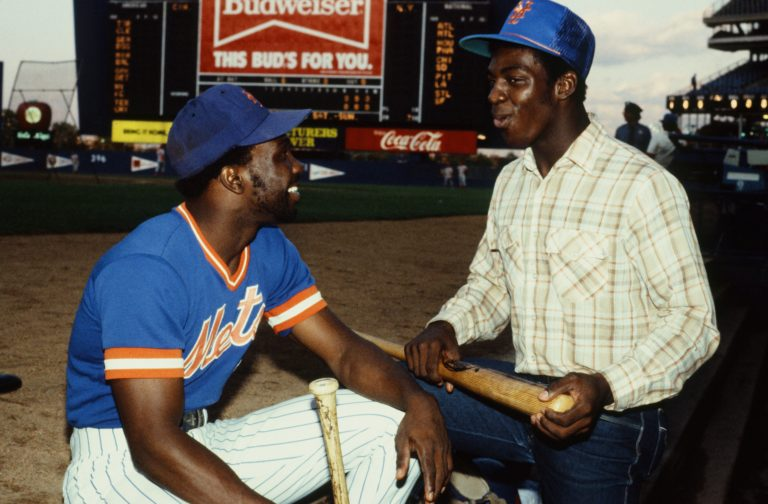 Mookie Wilson Chatting with Unknown Person at Shea Stadium
