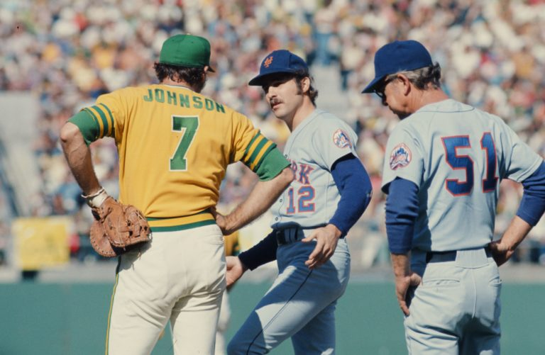Ken Boswell chats with Oakland Athletic Deron Johnson during 1973 World Series