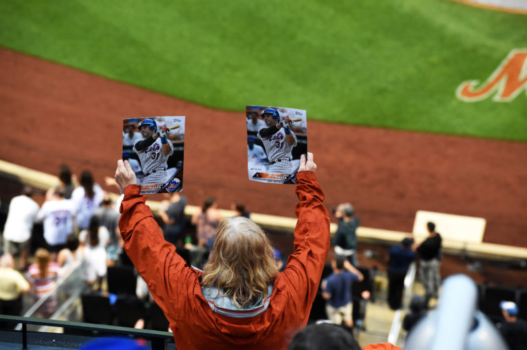Fan Holding Two Photos of Mike Piazza in the Stands