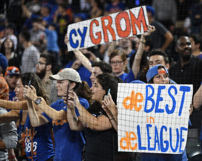 Fans Hold Up Signs for Jacob deGrom during Game on September 26, 2018