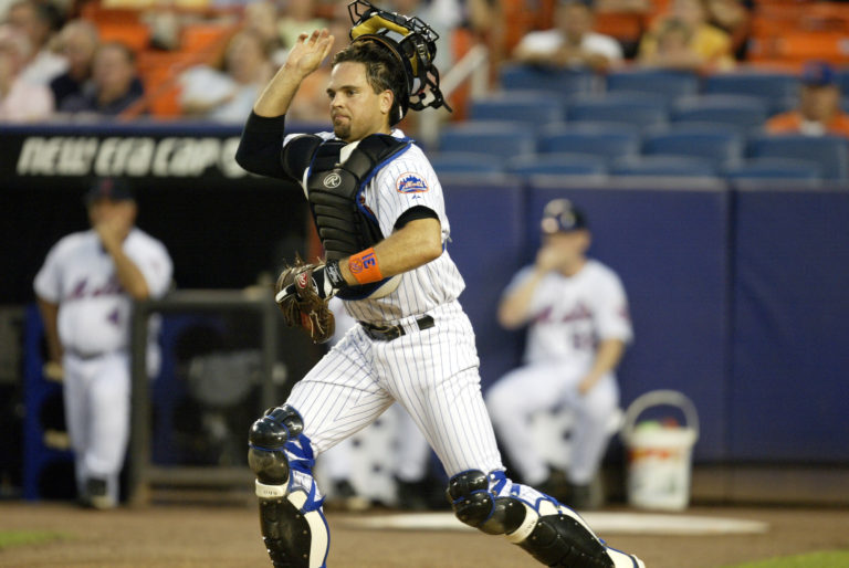 Mike Piazza Removes Mask to Field a Ball