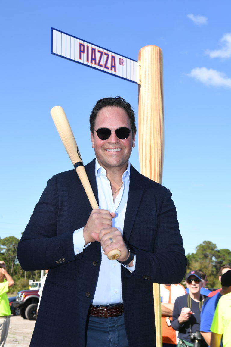 Mike Piazza Posing In Front of Streed Sign that Reads Piazza Dr