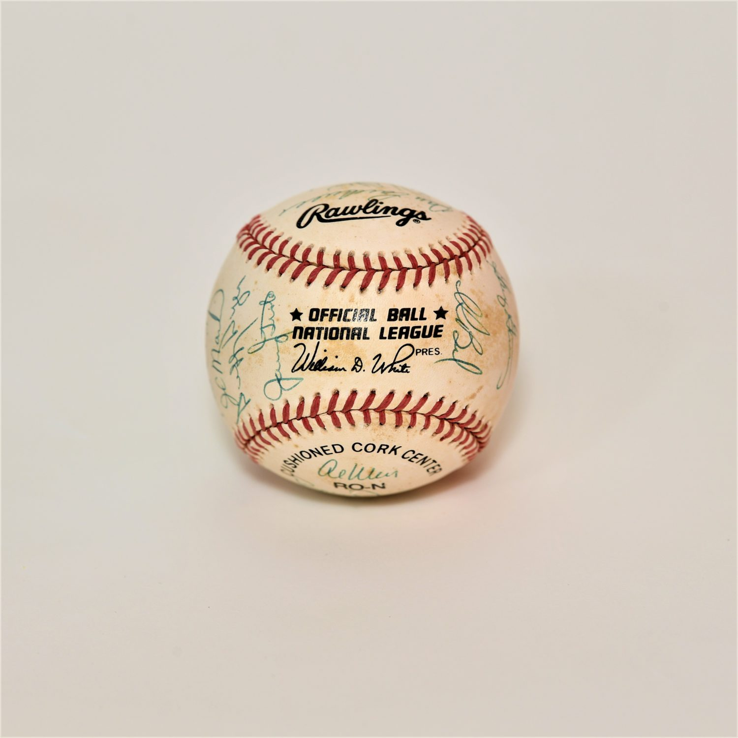 Front of baseball with scuff marks, signatures and text that reads,